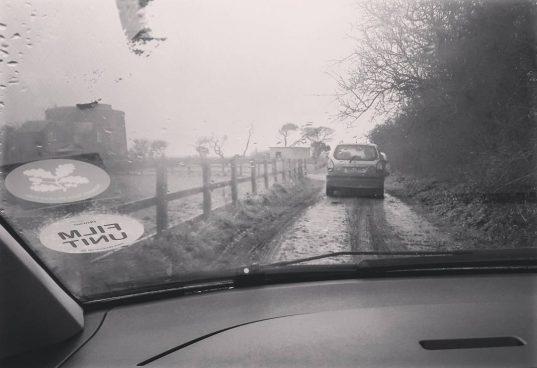Film Unit car driving down muddy Suffolk track