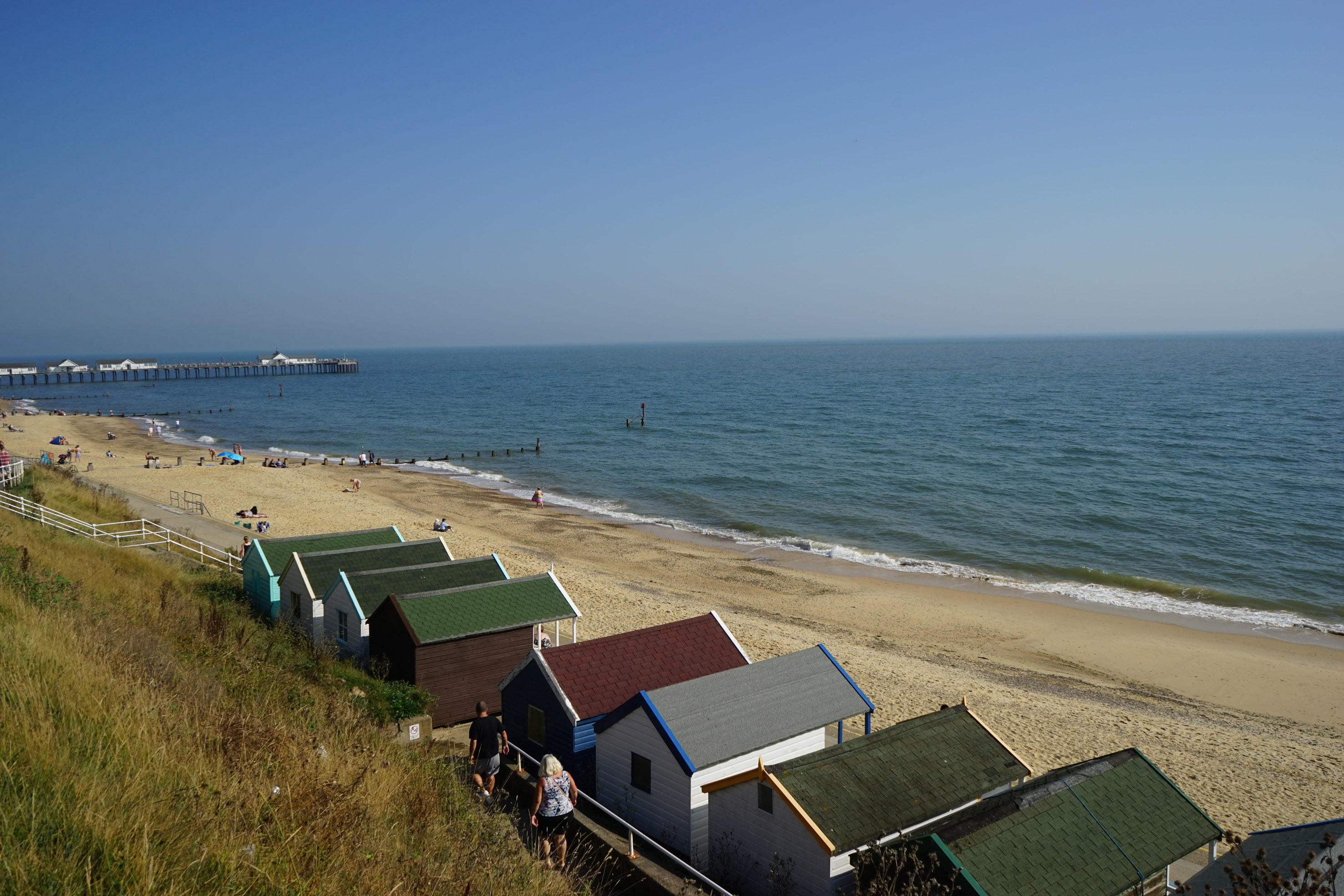 Southwold Seafront view of beach huts and Pier